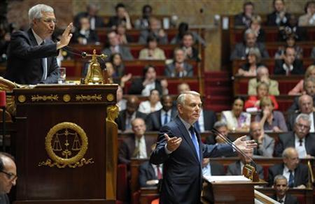 French Prime Minister Jean-Marc Ayrault (R) delivers his speech on the new Socialist government's immediate economic policy plans before newly-elected deputies as National Assembly Speaker Claude Bartolone asks for silence at the National Assembly in Paris July 3, 2012. REUTERS/Philippe Wojazer
