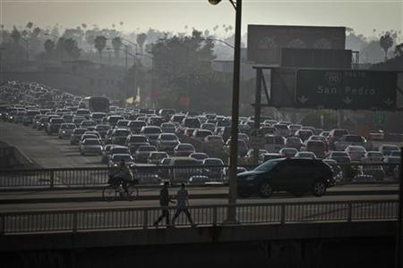 Traffic is backed up in all directions as it moves through downtown on Interstate 110 in Los Angeles, California March 22, 2012. REUTERS/Bret Hartman/Files
