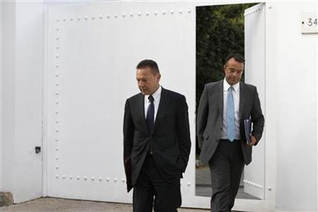 Newly appointed Greek Finance Minister Yannis Stournaras (C) and his alternate Christos Staikouras leave the residence of Prime Minister Antonis Samaras (not pictured) after their meeting at Kifissia suburb, north of Athens June 26, 2012. REUTERS/John Kolesidis