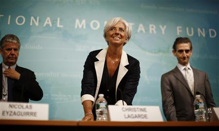 International Monetary Fund Managing Director Christine Lagarde arrives for a news conference following the release of the IMF's annual report on the U.S. economy, at the IMF headquarters in Washington, July 3, 2012. REUTERS/Jason Reed