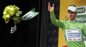 Liquigas-Cannondale rider and sprinter green jersey holder Peter Sagan of Slovakia throws a bunch of flowers on the podium after winning the third stage of the 99th Tour de France cycling race between Orchies and Boulogne sur mer, July 3, 2012. REUTERS/Bogdan Cristel