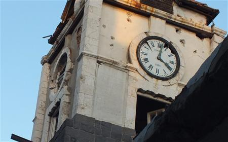 The damaged clock tower of the Orthodox school for girls is seen after fighting between Syrian rebel fighters and President Bashar al-Assad's forces in the central city of Homs July 2, 2012. REUTERS/Yazen Homsy
