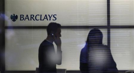 People walk inside Barclays Bank's headquarters in the financial district of Canary Wharf, east London, July 3, 2012. Barclays Plc Chief Executive Bob Diamond quit on Tuesday under a barrage of fire from politicians, the highest-profile casualty of an interest rate-rigging scandal that spans more than a dozen major banks across the world. REUTERS/Andrew Winning