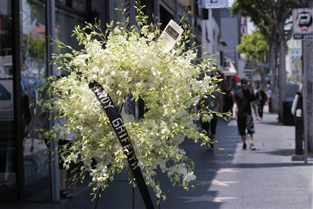 A wreath of flowers is pictured on the star of actor Andy Griffith on the Walk of Fame in Hollywood, California July 3, 2012. REUTERS/Mario Anzuoni