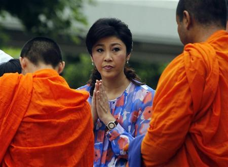 Thai Prime minister Yingluck Shinawatra prays on her birthday at her house in Bangkok June 21, 2012. REUTERS/Sukree Sukplang