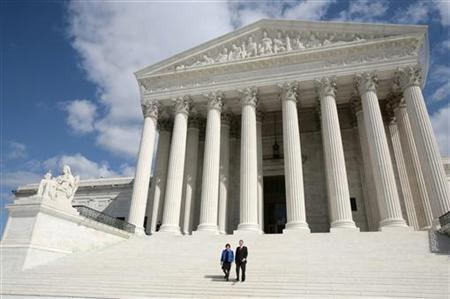 Justice Elena Kagan walks down the steps of the Supreme Court with Chief Justice of the United States John Roberts following her formal investiture ceremony in Washington October 1, 2010. REUTERS/Larry Downing