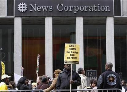 Protesters march outside the News Corp. headquarters in New York February 19, 2009. Hundreds of demonstrators rallied to boycott the New York Post, branding the newspaper as racist for publishing a cartoon that appeared to compare President Barack Obama to a chimpanzee. REUTERS/Brendan McDermid