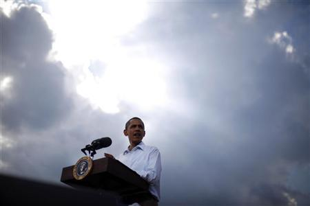 U.S. President Barack Obama stands under the sun breaking through clouds at a town hall-style event in Alpha, Illinois August 17, 2011. REUTERS/Jason Reed