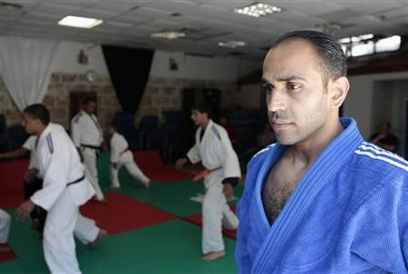 Palestinian judoka Maher Abu Rmeileh pauses during a training session at a gym in Arab East Jerusalem June 20, 2012. REUTERS/Ammar Awad