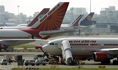 Air India aircrafts stand on the tarmac at the airport in Mumbai September 27, 2009. REUTERS/Punit Paranjpe/Files