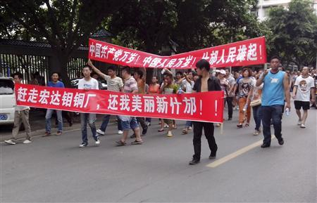 Local residents march with banners during a protest along a street in Shifang, Sichuan province July 3, 2012. REUTERS/Stringer