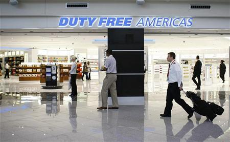 Passengers and employees walk past a Duty Free shop at the newly opened Maynard H. Jackson Jr. International Terminal at Hartsfield-Jackson Atlanta International Airport in Atlanta, Georgia May 16, 2012. REUTERS/Tami Chappell