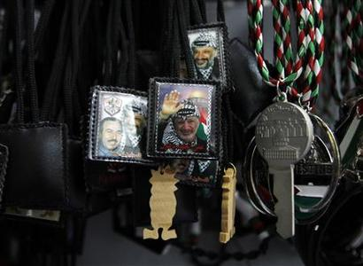 Items bearing a picture of late Palestinian leader Yasser Arafat are displayed at a curio shop in the West Bank city of Ramallah July 4, 2012. The Palestinian Authority agreed on Wednesday to the exhumation of Arafat's body after new allegations that he was poisoned with the radioactive element polonium-210 in 2004. REUTERS/Mohamad Torokman