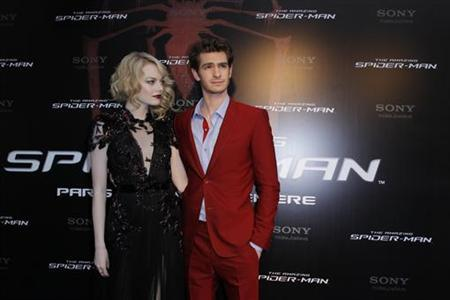 Actor Andrew Garfield (R) and U.S. actress Emma Stone arrive for the French premiere of ''The Amazing Spider-Man'' in Paris June 19, 2012. REUTERS/Gonzalo Fuentes
