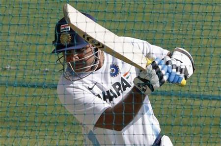 Virender Sehwag bats in the nets during a practice session in Indore December 7, 2011. REUTERS/Amit Dave