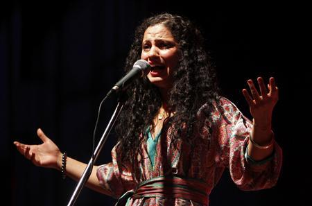 Tunisian singer Emel Mathlouthi sings during a concert in Baghdad July 3, 2012. Attacks on art in Tunisia by Salafi Islamists are mainly driven by frustration over the injustices of daily life in the North African country rather than pure religious ideology, revolutionary singer Mathlouthi said. Picture taken July 3, 2012. TUNISIA-SINGER/ REUTERS/Saad Shalash