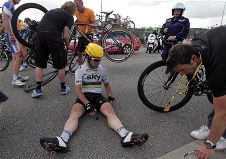 Team Sky rider Mark Cavendish of Britain sits on the ground after a fall during the fourth stage of the 99th Tour de France cycling race between Abbeville and Rouen, July 4, 2012. REUTERS/Joel Saget