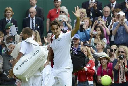 Roger Federer of Switzerland (R) celebrates after defeating Mikhail Youzhny of Russia (L) in their men's quarter-final tennis match at the Wimbledon tennis championships in London July 4, 2012. REUTERS/Dylan Martinez
