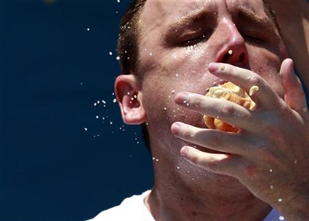 Joey Chestnut competes in the 2012 Nathan's Famous Fourth of July International Eating Contest at Coney Island in the Brooklyn borough of New York July 4, 2012. REUTERS/Eric Thayer