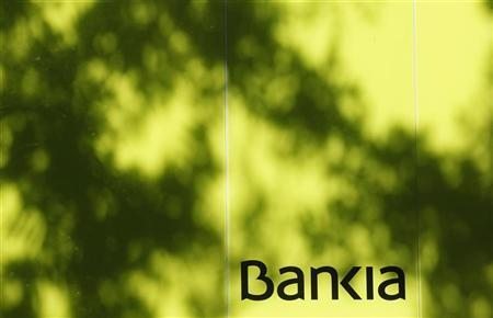 The logo of Bankia is seen at an ATM machine in Madrid June 25, 2012. REUTERS/Andrea Comas