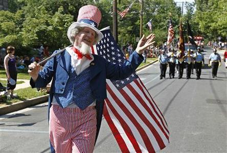 Jeffrey Silverstone, dressed as ''Uncle Sam,'' marches in the Takoma Park Independence Day parade during celebrations of the United States' Fourth of July Independence Day holiday in Takoma Park, Maryland July 4, 2012. REUTERS/Jim Bourg