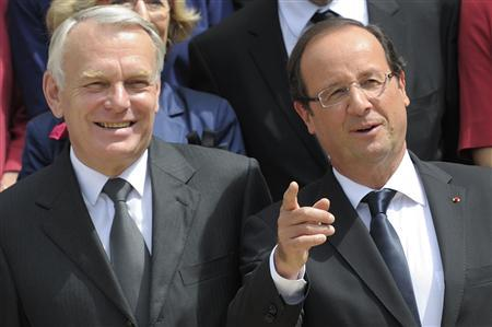 France's President Francois Hollande (R) and Prime Minister Jean-Marc Ayrault pose for the traditional family photo of the government after a minor government reshuffle outside the Elysee Palace in Paris July 4, 2012. REUTERS/Philippe Wojazer