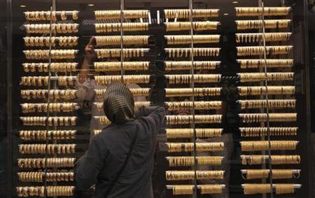 A woman looks into a jewellery shop where gold bangles are on display in Istanbul June 29, 2012. REUTERS/Murad Sezer