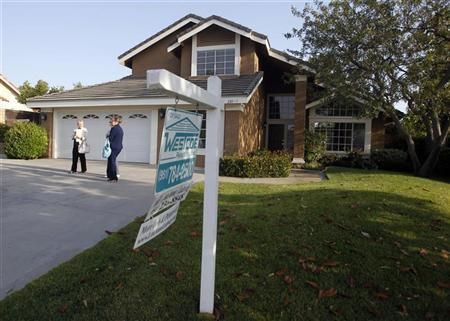 Realtor April Bolin (R) shows a home to Amy (L) and Eddie Deon during an upswing in the housing market, in Riverside, California May 24, 2012. REUTERS/Alex Gallardo