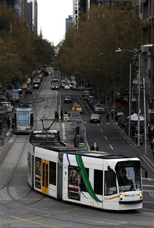 A tram travels on a road in central Melbourne May 13, 2010. REUTERS/Mick Tsikas