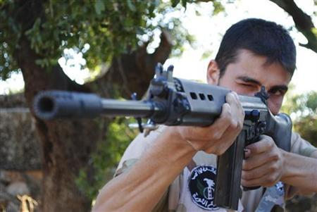 A member of the Free Syrian Army (The Brigade of the Revolution's Shield) attends a daily training in Sarmada, north of Idlib province, July 4, 2012. REUTERS/Shaam News Network/Handout