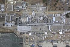 """Вид с воздуха на АЭС """"Фукусима-1"""", 20 марта 2011 года. Прошлогоднюю аварию на японской АЭС """"Фукусима-1"""" можно было предотвратить, а виноваты в случившемся власти, регуляторы и оператор станции, объявила в четверг свои выводы экспертная комиссия, расследовавшая крупнейшее ядерное бедствие в Японии за последнюю четверть века. REUTERS/Air Photo Service"""