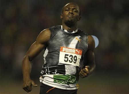 Usain Bolt runs during their men's 100 meters final event at the Jamaican Olympic trials in Kingston city, June 29, 2012. REUTERS/Ivan Alvarado