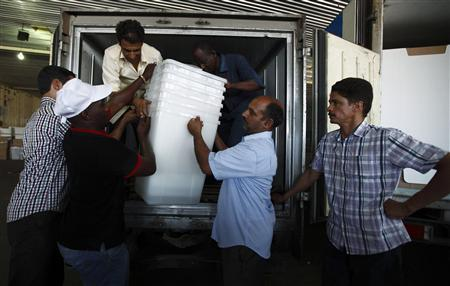 Electoral workers load ballot boxes onto a truck, to be distributed to polling stations in Tripoli July 4, 2012. REUTERS/Zohra Bensemra