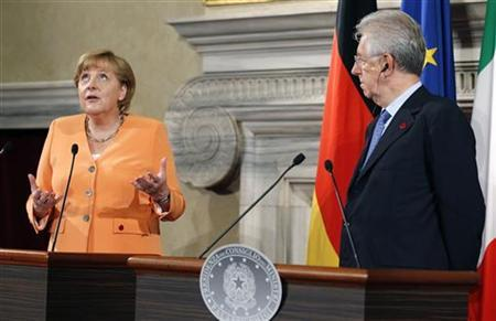 German Chancellor Angela Merkel (L) talks with Italian Prime Minister Mario Monti during a news conference at Villa Madama in Rome July 4, 2012. REUTERS/Max Rossi