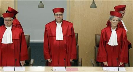 President of the German Constitutional Court Andreas Vosskuhle (3rd R) and other judges arrive for the proclamation of a verdict on the German Government's European Stability Mechanism and the Euro Plus Pact in Karlsruhe June 19, 2012. REUTERS/Alex Domanski