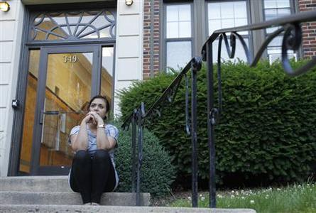 Rachel Pita, a tenant at 349 Pleasant Street, a 200-unit apartment complex, sits on the front steps of her building as she attends a meeting of a group called 'Malden Tenants United' who are fighting to battle proposed rent increases in Malden, Massachusetts June 17, 2012. REUTERS/Jessica Rinaldi