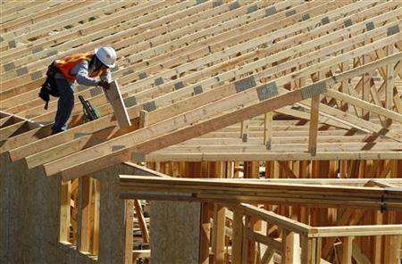 A construction worker builds a new home at a development area in San Marcos, California March 20, 2012. REUTERS/Mike Blake