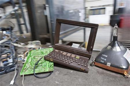A circuit board, screen and plastic front from a French Minitel terminal which are broken down into its components, are collected for recycling in Portet-Sur-Garonne, southwestern France May 23, 2012. REUTERS/Bruno Martin/Files