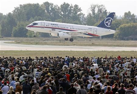 Visitors watch a Sukhoi Superjet 100 during the MAKS-2009 international air show in Zhukovsky outside Moscow in this August 22, 2009 file photo. REUTERS/Sergei Karpukhin