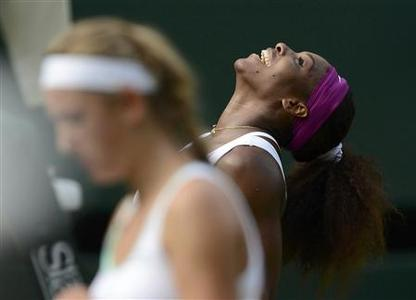 Serena Williams of the U.S. celebrates after defeating Victoria Azarenka of Belarus (L) in their women's semi-final tennis match at the Wimbledon tennis championships in London July 5, 2012. REUTERS/Dylan Martinez