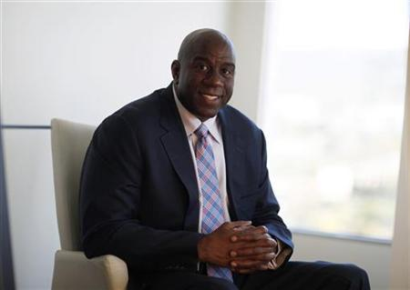 Earvin ''Magic'' Johnson poses for a portrait at his offices in Beverly Hills, California, June 25, 2012. REUTERS/Mario Anzuoni