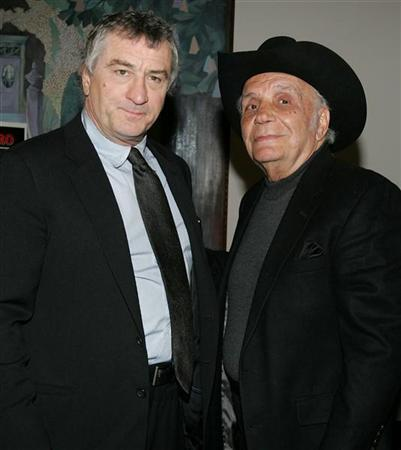 Actor Robert DeNiro, (L), with boxer and author Jake LaMotta, pose for photographers at a screening celebrating the 25th anniversary of ''Raging Bull'' at the Ziegfeld Theater in New York on January 27, 2005. REUTERS/Stringer
