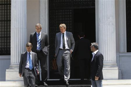 International Monetary Fund's (IMF) Poul Thomsen (C), European Central Bank's (ECB) Klaus Masuch (top L) and European Commission director Matthias Morse (L) leave Greek Prime Minister's Antonis Samaras (not pictured) office in Athens July 5, 2012. REUTERS/John Kolesidis