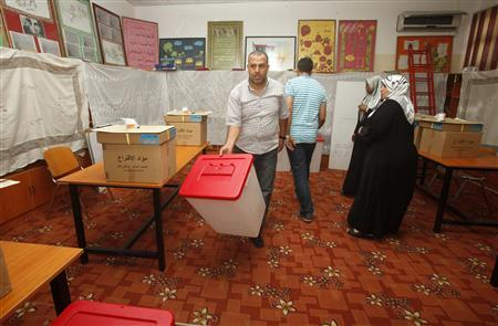 Electoral workers arrange polling materials at a polling station in Tripoli July 5, 2012. REUTERS/Ismail Zitouny