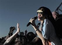 Rihanna goes into the crowd during a performance at the Hackney Weekend festival at Hackney Marshes in east London, June 24, 2012. REUTERS/Olivia Harris