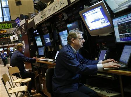 Traders work on the floor of the New York Stock Exchange, July 3, 2012. REUTERS/Brendan McDermid