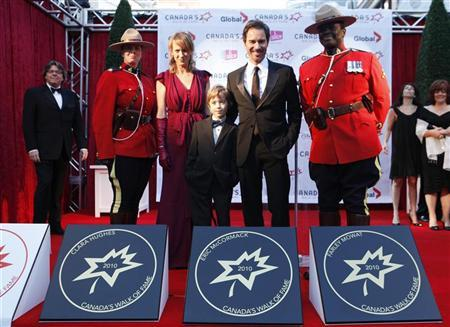 Actor Eric McCormack poses with his star on the red carpet with his wife Janet Leigh Holden and his son Finnigan during the 13th annual Canada's Walk of Fame in Toronto, October 16, 2010. REUTERS/Mark Blinch