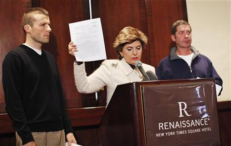 Attorney Gloria Allred (C), flanked by Bobby Davis (L) and Mike Lang, announces the filing of a lawsuit against Syracuse University in a news conference in New York December 13, 2011. REUTERS/Eduardo Munoz