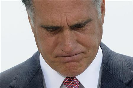U.S. Republican Presidential candidate Mitt Romney pauses during his reaction to the Supreme Court's upholding key parts of President Barack Obama's signature healthcare overhaul law during a rooftop news conference in Washington June 28, 2012. REUTERS/Jonathan Ernst