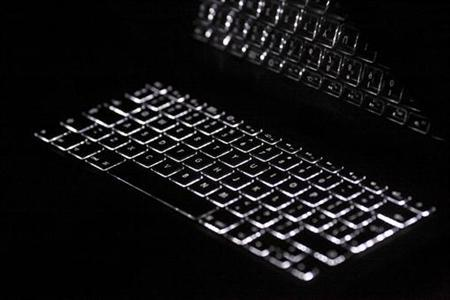 Backlit keyboard is reflected in the screen of a computer in Warsaw February 6, 2012. REUTERS/Kacper Pempel/Files